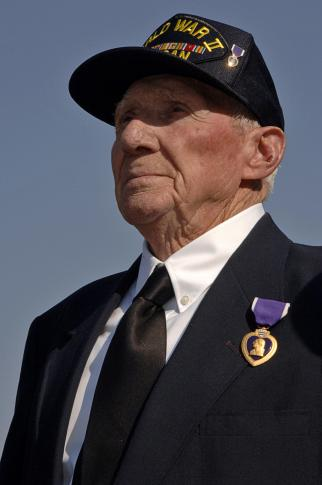 Samuel R. Jones, 84, is awarded a Purple Heart during a ceremony aboard the Coast Guard Cutter Diligence in Wilmington, N.C., Thursday, March 13, 2008.