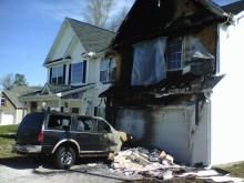 Family Unhurt After SUV Fire Spreads to Home