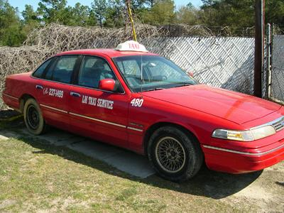 A photograph of William James Simon's red, Ford Crown Victoria was released to the media Tuesday.