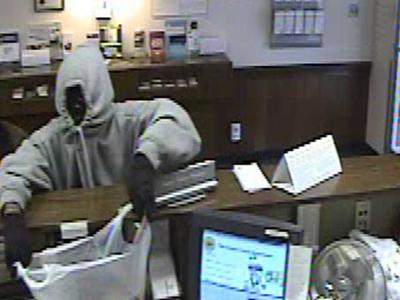 A man, seen in this surveillance photo, walked up to a BB&T teller and demanded money Thursday, April 3, 2008.