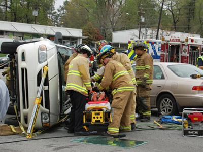 Firefighters remove a victim from a car involved in a four-vehicle wreck on South Saunders Street on April 6, 2008. (Photo by Scott Brownell)