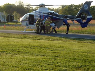 A 7-year-old boy, hit by a vehicle Sunday, is loaded onto a helicopter for transport to Duke University Hospital. (Photo Courtesy of Heather Freeman)