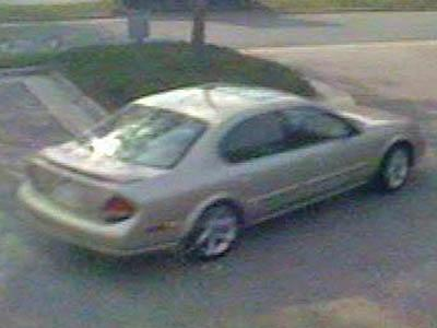 A bank surveillance camera video shows the car authorities suspect was used in a bank robbery on April 25, 2008.