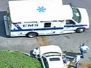Police and paramedics respond to a Hess gas station in southeastern Raleigh where a car hit a woman on Friday, April 25, 2008.