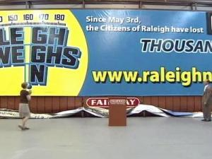 The billboard has a counter display to show the total number of pounds lost by Raleigh Weighs In participants.