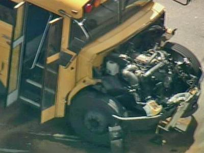 The hood fell off a school bus, leaving its engine exposed, in an accident at New Bern Avenue and Freedom Drive in Raleigh on Monday, May 19, 2008.