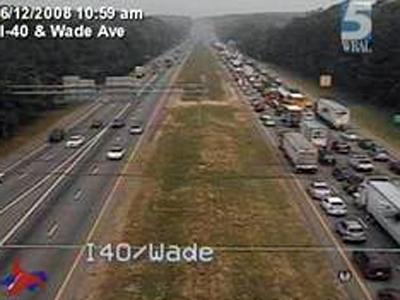A traffic camera shows backups on Interstate 40 West extending to Wade Avenue after a wreck near mile marker 285.