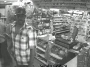 Surveillance video caught three men who authorities say committed an armed robbery at Las Carolinas Grocery and Grill, 4905 Guy Road in Clayton, on Friday, June 27, 2008.