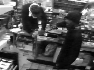 Goldsboro police released this surveillance image of two men robbing the Pantry convenience store on Tuesday, July 15, 2008.