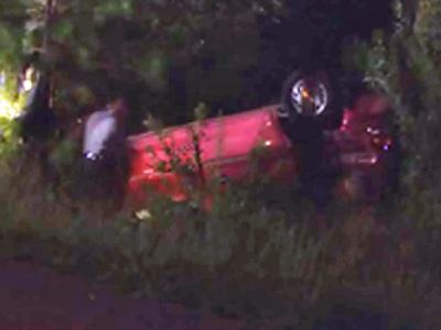 The driver was entangled in the overturned vehicle.