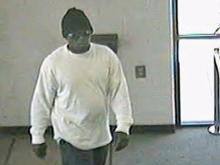 A surveillance photo of the suspect in the July 24, 2008 robbery of the ABC store, 204 Highway 70 East in Garner. (photo courtesy of the Raleigh Police Department)