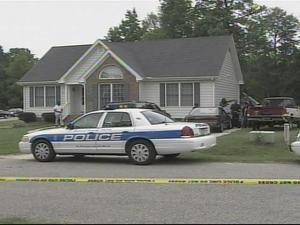 Police investigate after shots were fired outside of a house at 801 Pittsboro St. in Fuquay-Varina.