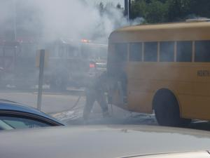 Firefighters extinguish a fire on a Wake school bus July 28, 2008. (Photo by John R. Astle, N.C. DOT)