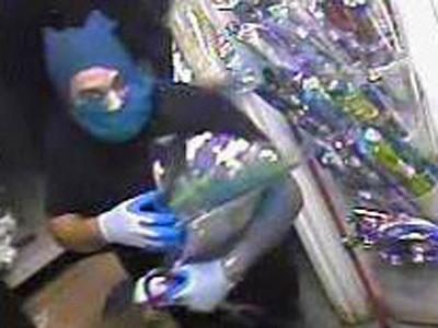 The suspect steals a bouquet of flowers from Ming Rose Florist on Aug. 1.