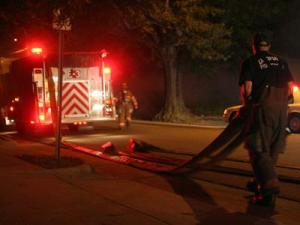 The scene of a fire at 521 North Mangum Street in Durham in the early morning hours of Aug. 15, 2008. (Photo by Rob Fisher)