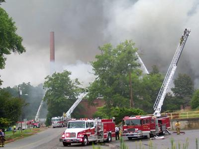 Firefighters battle a large blaze at the former Milliken textile plant in Robbins on Aug. 17, 2008. (photo by Lynn Pennington)