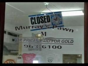 Murray's Pawn shop displayed a closed sign as deputies searched the business during a raid.