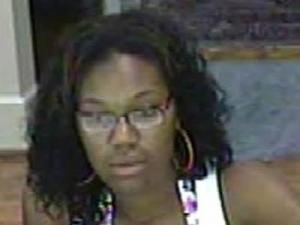 A bank security photo of a woman identifying herself as Natalie Monique Robinson