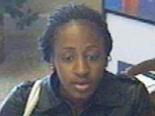 A bank security photo of a woman identifying herself as Jelyenne Gomez