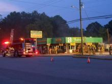 Firefighters at the scene of a blaze at Patrick's Restaurant in Kenly on Aug. 30, 2008. (photo by Rayne Biggs)