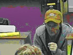The suspect in a Fayetteville bank robbery was caught on video Sept. 17, 2008.