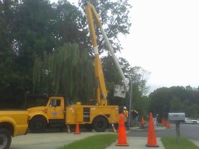 Power crews work to repair downed electrical lines on Garrett Road in Durham on Sept. 25, 2008.