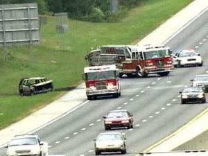 An image of a two vehicle wreck that caused one of the cars to catch on fire on Interstate 40 in Durham on Oct. 11, 2008.
