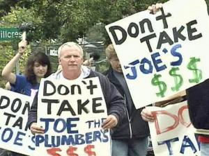 "Republicans carried plumbers and signs saying ""Don't Take Joe's $$$"" in march in downtown Raleigh Saturday, Oct. 25, 2008."