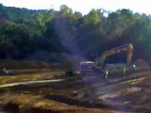 Idled construction equipment at the scene of an investigation in Fayetteville
