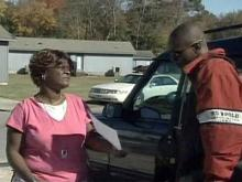 Family and friends of Zavreail Holmes, who was found dead in his Fayetteville home on Oct. 8, solicit information about his death by handing out fliers on Nov. 8, 2008.