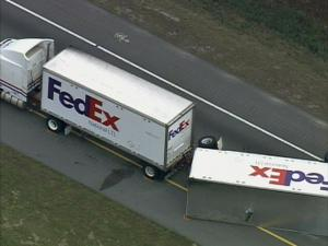 A FedEx tractor-trailer crashed on Interstate 95 near Rocky Mount Wednesday morning, causing major back-ups on the road.
