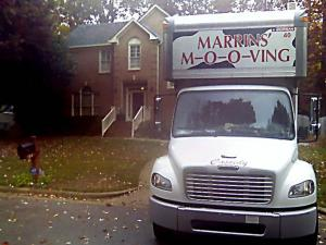 Furnishings were moved out of the Cary home of Brad and Nancy Cooper on Nov. 13, 2008.