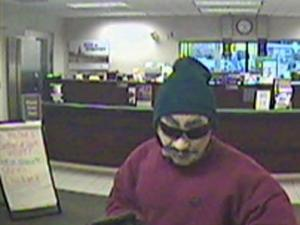 Security cameras caught a photo of man Garner police say robbed the SunTrust bank, 118 Small Pine Drive, off U.S. Highway 401, around 4:30 p.m. Wednesday, Nov. 19, 2008.