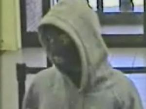 A security camera shows a man who sheriff's deputies said brandished a semiautomatic handgun and demanded money from the tellers at Bank of America, 1109 N. Bragg Blvd in Spring Lake, Wednesday, Nov. 19, 2008.