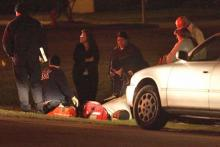 Emergency medical personnel help treat Rocky Mount Police Officer Jill Tyson-Johnson, who was hurt in one of two wrecks allegedly caused a drunk driver Thursday, Nov. 20, 2008. (Photo courtesy of the Rocky Mount Telegram)