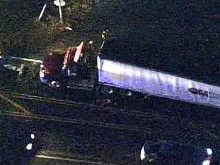 An overturned tractor-trailer tied up traffic on N.C. 54 near Carrboro on Nov. 25, 2008.
