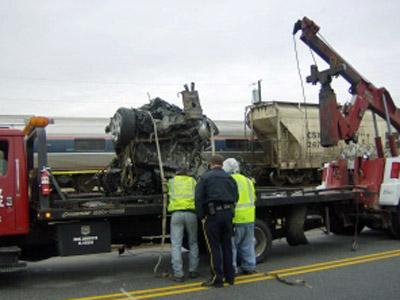 Authorities tow away a vehicle that had been hit by one train and pushed into another in Rocky Mount on Nov. 29, 2008. (Submitted by Bridgette Howe)