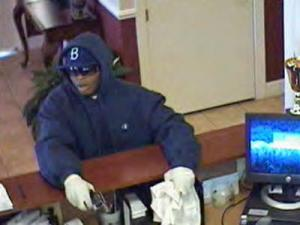 The armed man is seen in this surveillance video from the Crescent State Bank.