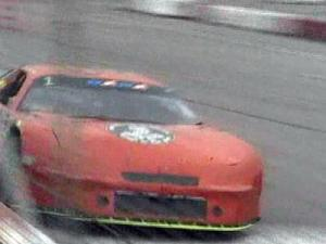 A race car speeds by during the annual Thanksgiving Classic race at Southern National Raceway Park on Dec. 6, 2008.