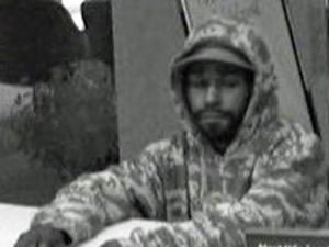 Surveillance photos from SunTrust Bank show the suspect in a Dec. 15 robbery.