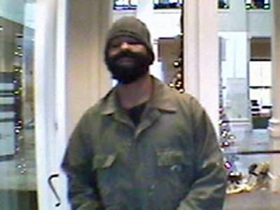 A surveillance image of the suspect in the robbery of First Citizens Bank in Goldsboro on Dec. 19, 2008.