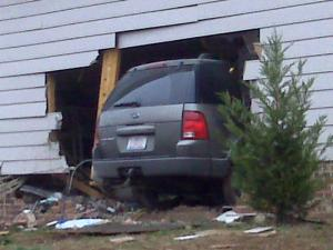 An SUV went through the wall of the garage at 1 Regan Court in Durham on Jan. 2, 2009.