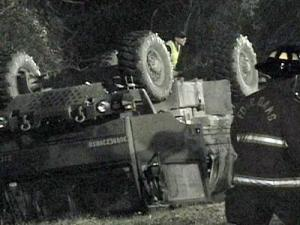 A military vehicle was flipped upside down in a ditch after an accident along Interstate 95 in Johnston County on Jan. 2, 2009.