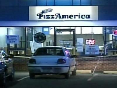 Raleigh police say an armed man went into this pizza parlor early Thursday and shot one of the employees in the arm during a robbery attempt.