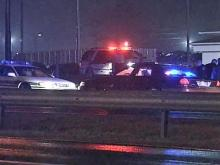 State troopers and other law enforcement vehicles are parked at the scene of a wreck on Interstate 95 in Dunn. Troopers say that after the wreck, Romeo Ribeiro, of New York State, attacked a state trooper and emergency vehicles with a claw hammer shortly before midnight Saturday, Jan. 10, 2008.