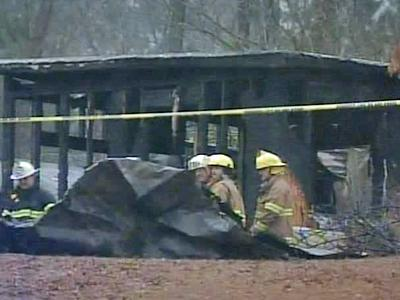 Firefighters investigate a fatal mobile home fire Sunday at 453 Almon Road, off Harper House Road, north of Newton Grove.