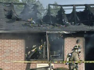 Firefighters battle a blaze at the Biltmore Hills Apartment unit, 2213 Garner Road, on Sunday afternoon.