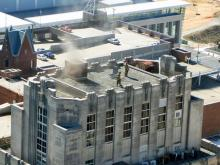 A faulty furnace sent smoke pouring from the roof of a county-owned office building in downtown Raleigh, bringing out firefighters and prompting an evacuation of the building Monday, Feb. 9, 2009.