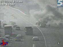 Smoke billowed from a car fire along I-40 Wednesday morning.