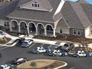 Raleigh police cars surround a building at the  Villa Apartments, off Jones Franklin Road, on Friday, Feb. 20, 2009. A man police wanted to talk to refused to come out of his apartment for3½ hours.